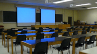 Classroom with projection screens.