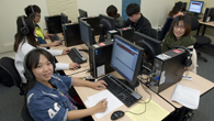 Group of English Language Program students working in a computer lab.