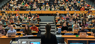 Large lecture hall filled with students.