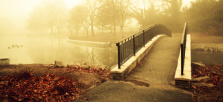Misty bridge over water in the fall.