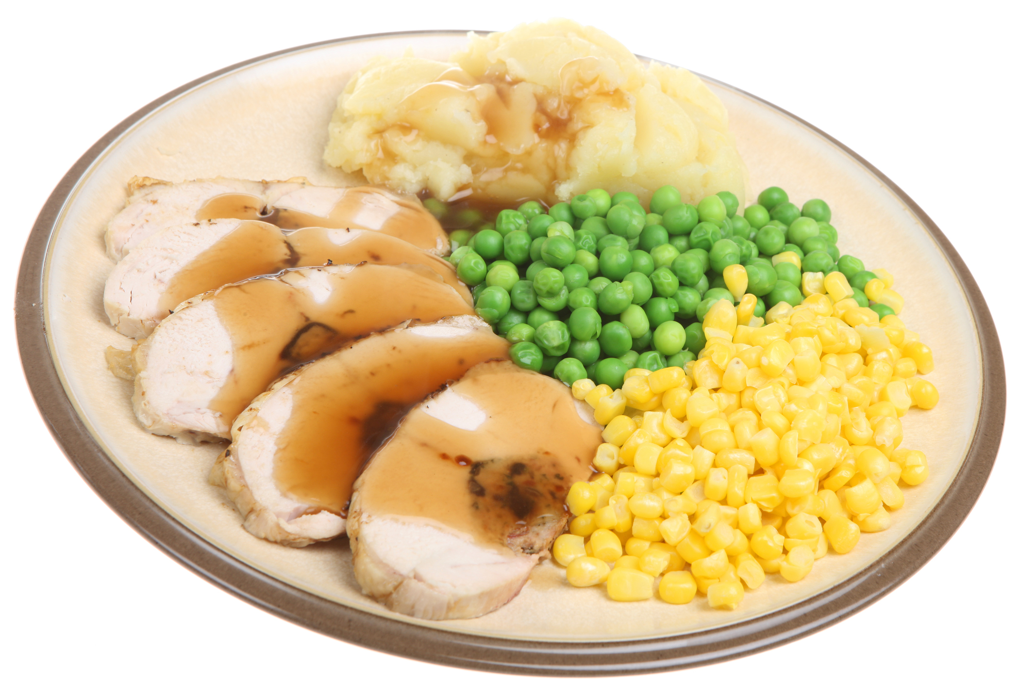 Plate of turkey, mashed potatoes, gravy and vegetables.